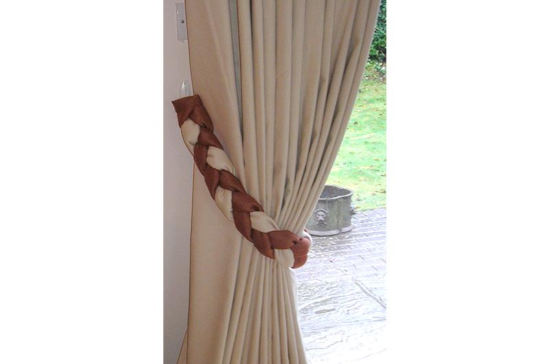 handmade bespoke plaited tieback detail